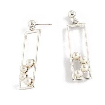 Long statement earrings with cream colored pearls
