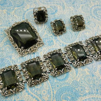 Sarah Coventry Celebrity 1962 Set Smoke  and Silver Tone  Clip Earrings  Bracelet Ring  and Brooch