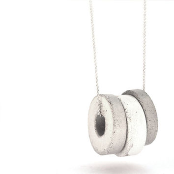 Statement Silver necklace, with three handmade gray and white concrete pendants, hangs on 925 silver necklace.