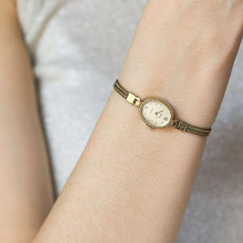 Delicate lady watch Seagull, gold plated women's wrist watch, cocktail watch tiny, oval watch her, women's watch bracelet