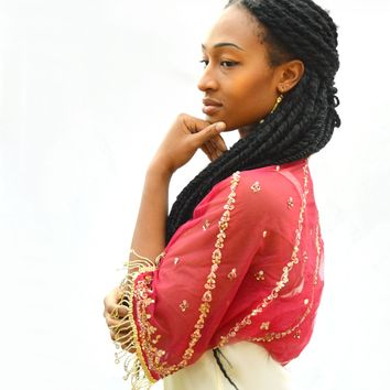 red and gold fringed shrug