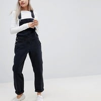 ASOS DESIGN Petite denim dungaree in washed black at asos.com