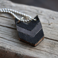 Chevron leather pendant in black and gray.