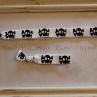 Skull and Crossbones Hair Tie and Headband.  by SweetLovesBowtique