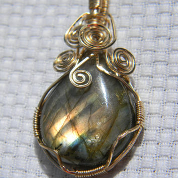 Gorgeous 22 mm x 29 mm Spectrolite Cabochon wire wrapped in 14 kt Gold Pendant
