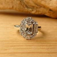 Emerald Cut Sapphire and Diamond Halo Ring