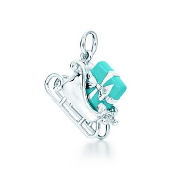 Tiffany & Co. -  Bow box sled charm in sterling silver with Tiffany Blue® enamel finish.