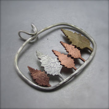 Conifer Forest Copper Silver and Brass Pendant by by BethMillner