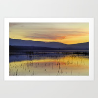 Calm sunset at the lake Art Print by Guido Montañés