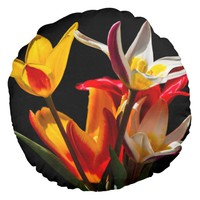 Tulip flowers against black background round pillow