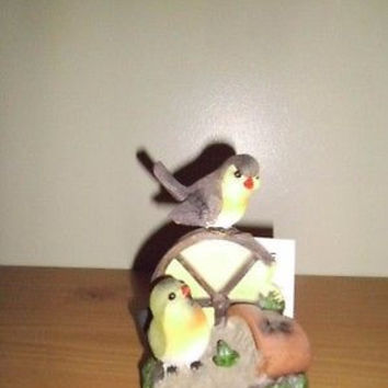 2 SMALL BIRDS PERCHED ON AND NEAR A WAGON WHEEL DECORATION; FIGURINE BRAND NEW