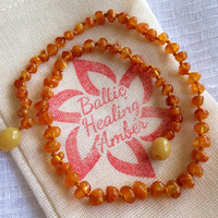 Baby Baltic Healing Amber necklace designed with 100% Baltic caramel colored round amber bead.