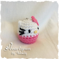Hello Kitty EOS Lip Balm Holder with clip to attach to a key chain or bag.  Hand crocheted, fits eos or similar lip balm.