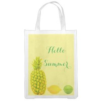 Pineapple lemon lime family groceries on yellow market totes