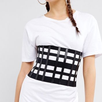 Seint Cut Out Cage Waist Belt with Zip Up at asos.com