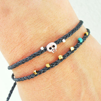 Tiny skull bracelet - rhodium plated skull bead on waxed nylon cord