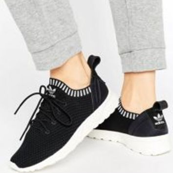 adidas Originals Dusky Pink Tubular Sneakers at asos.com