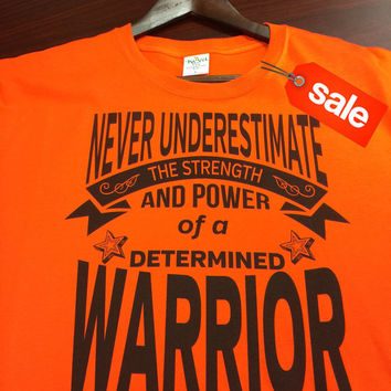 On Sale: Never Underestimate The Strength and Power of a Determined Warrior Orange Shirt (FREE SHIPPING in U.S)