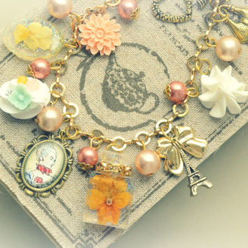 Paris theme dried viola flower altered art charm bracelet, charms including portrait, Eiffel tower, fake cream and flowers, gift under 20