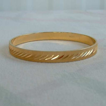 MONET Small Diamond Cut Goldtone Bangle Bracelet Etched Jewelry