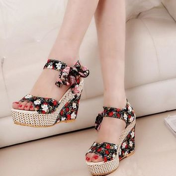 Wedge sandal with floral or plain design  Sizes:  6 - 9