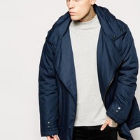 ASOS Asymmetric Parka Jacket With Drawstring In Navy at asos.com