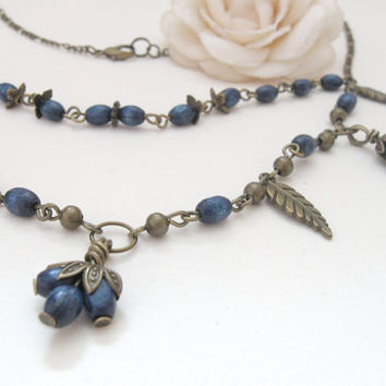 Blue Berries - brass necklace with navy wooden beads and bronze leaves