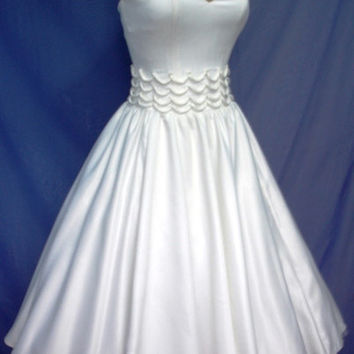 A 50s wedding or cocktail dress in white duchess by elegance50s
