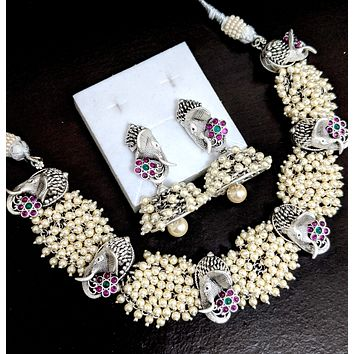 Grandeur pearl cluster bead tangled Lord Ganesha charm statement choker necklace and Jhumka earring set with kemp stone