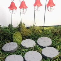 Fairy garden hanging lanterns and stepping stones. 10 piece set. Red fairy lights.