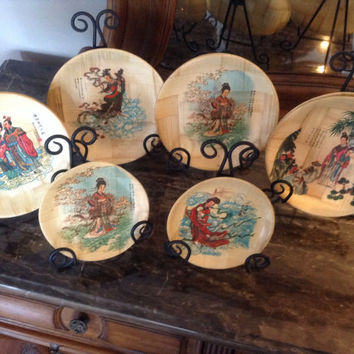 "Vintage collection of 1960's Geisha Bamboo plates seven 8"" dinner size plates and two 6.5"" dessert plates."