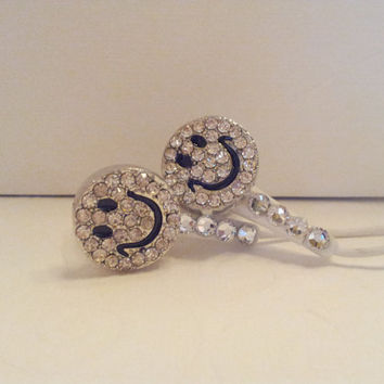 Swarovski crystals and  Rhinestone Smiley Face Earbuds