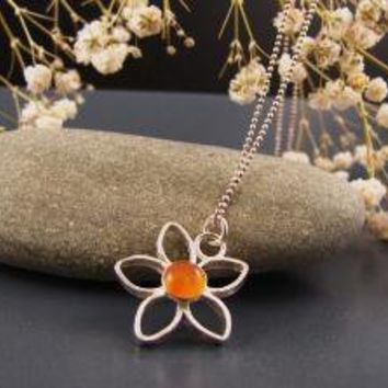 Delicate small flower pendant with a Carnelian by DvoraSchleffer