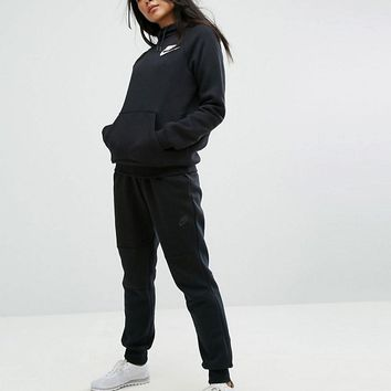 Nike Rally Pullover Hoodie & Sweat Pant Co-Ord in Black at asos.com