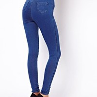 ASOS Uber High Waist Denim Tube Pants in Mid Vintage Wash at asos.com