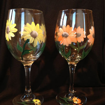 Gerber Daisy Wine Glasses orange and yellow tones . Beautiful flowers . Great for weddings , mother of the bride, bridal party