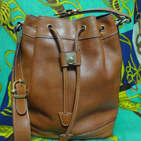 Vintage Celine tanned brown leather hobo bucket shoulder bag with golden drawstring hardware. Unisex