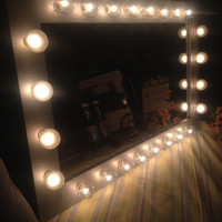 Lighted vanity mirror called DIVA. The all-in-one price mirror. Pine wood frame, painted silver.Light bulbs and dimmer switch included.