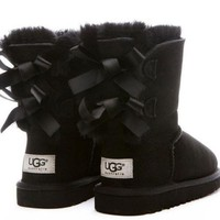 UGG: Bow Leather Boots Boots In Tube