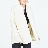 KNIT CAPE WITH SLEEVES