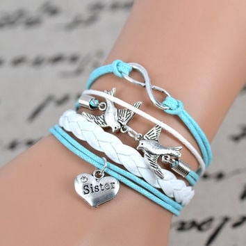 silver tone Peace Dove infinity charm bracelet,sister charm ,light blue white leather bracelet. = 1932519492