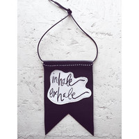 "Wall hanging- ""Inhale, exhale"" hand embroidered on cream muslin with black leather backing relaxing mantra, words of wisdom home decor"