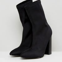 Public Desire Libby Black High Heeled Sock Boots at asos.com