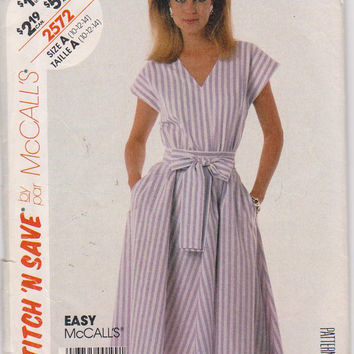 Vintage 1980s easy sleeveless pullover dress pattern with elastic waist misses size 10 12 14 McCalls Stitch n Save 2572 UNCUT