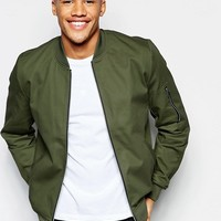 ASOS Bomber Jacket With Sleeve Zip In Khaki at asos.com