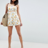 ASOS DESIGN cami romper with cut out detail in linen in floral print at asos.com