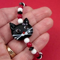 Girls small cat bracelet black white red beaded Hello Kitty Lampwork