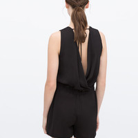 Short jumpsuit with bow at waist