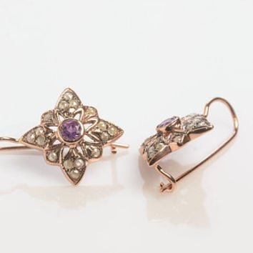 Dropped Earrings Star Shaped with diamonds surrounding a single Amethyst Wire back with hook and lever