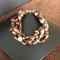 Pearls and glass beaded multi strand bracelet in browns, creams, and golds